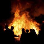 People at a bonfire