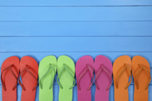 Flip Flops sandals in summer on vacation with copyspace